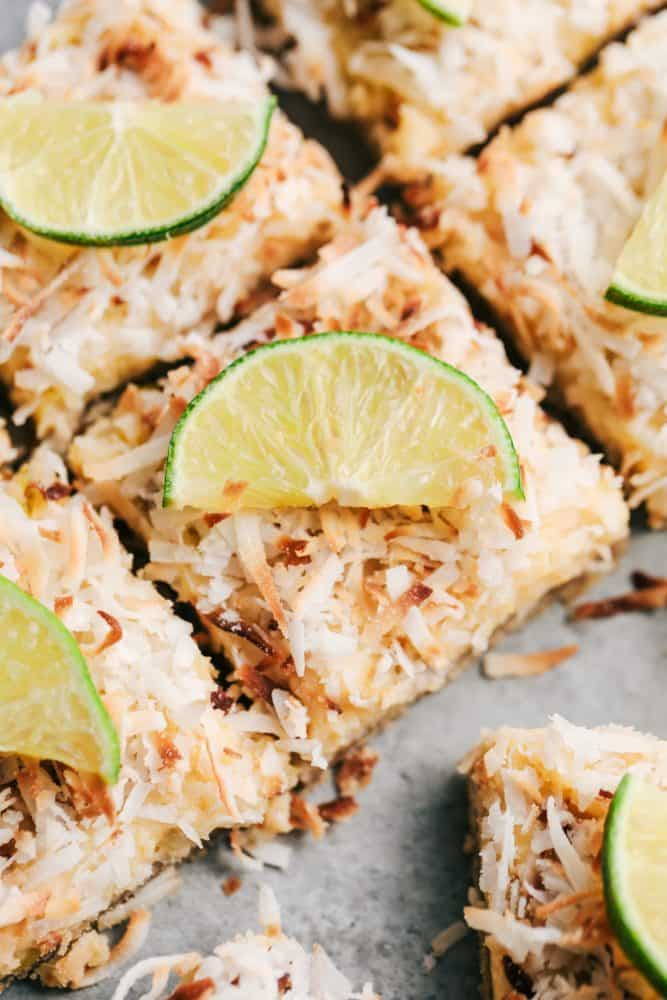 Close up of sliced Coconut Lime Butter Bars with freshly sliced lime on top.