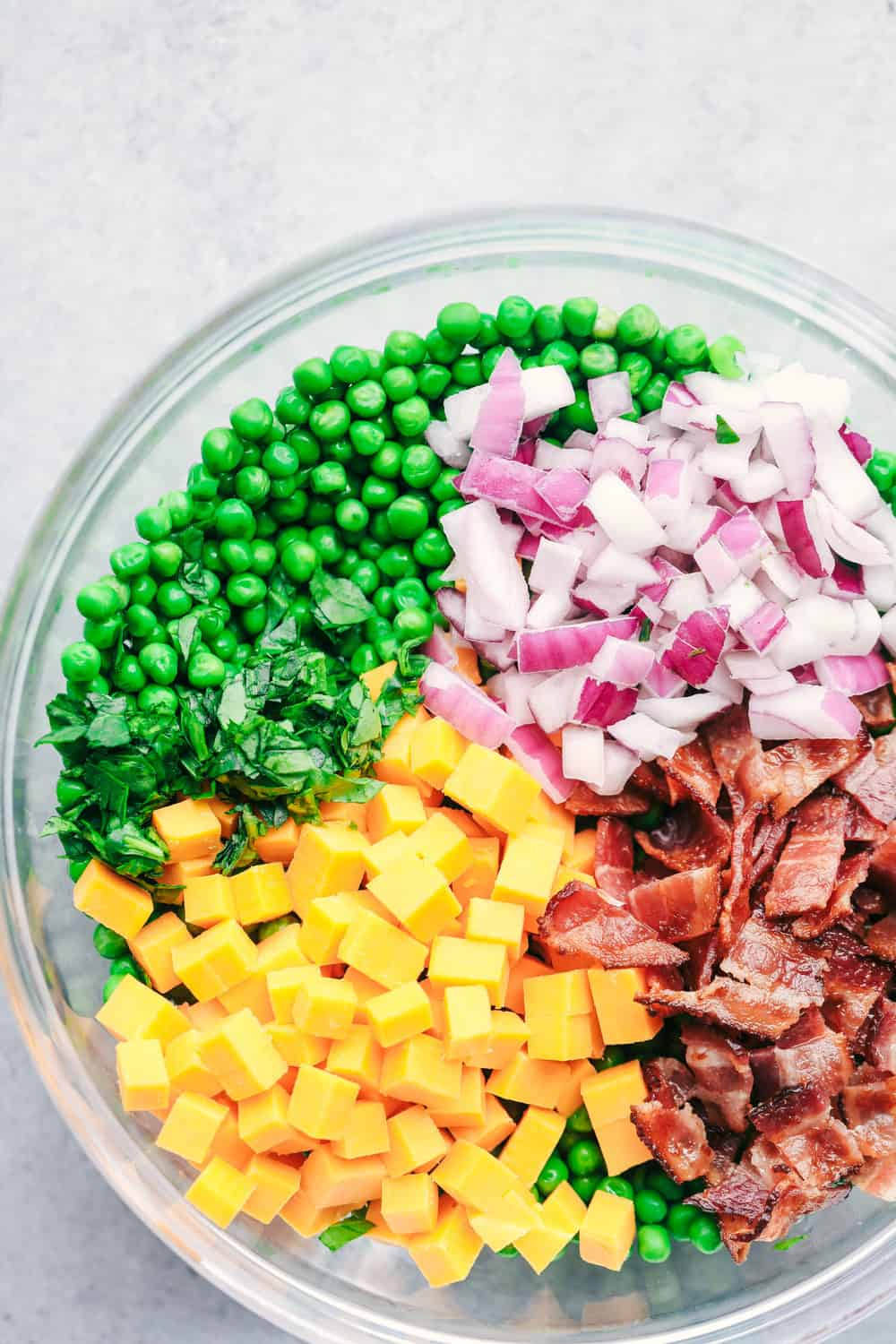 Creamy Pea Salad with Bacon ingredients before they are mixed together in a bowl.