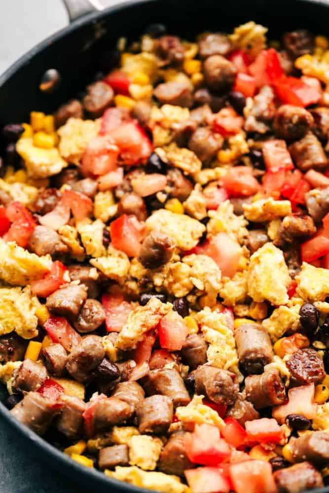 Southwest Sausage and Egg stuffing for mushrooms in a frying pan.