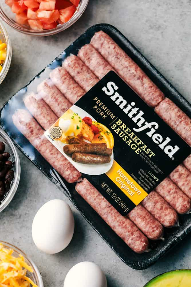 A package of Smithfield Sausage and two un-cracked eggs.