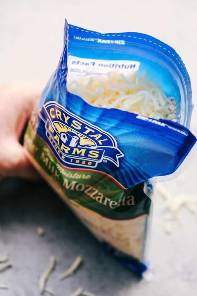 Opened bag of Crystal Farms Whole Milk Mozzarella Cheese.