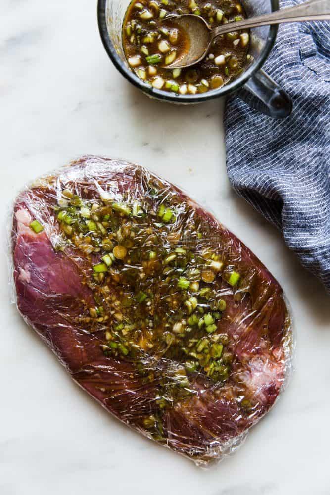 Brown Sugar Garlic Flank Steak wrapped in Reynolds Plastic Wrap.