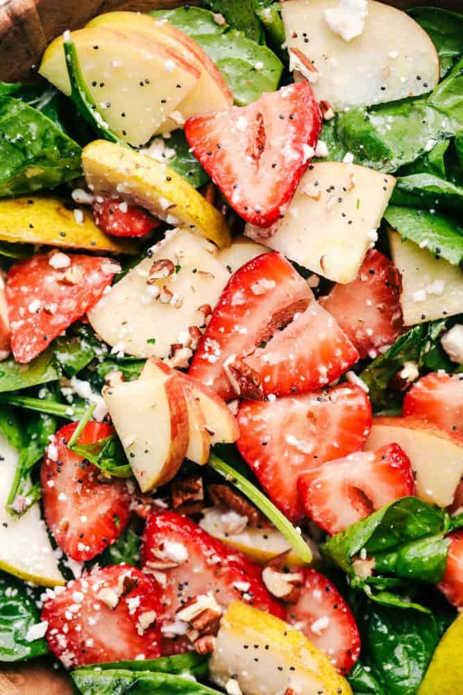 Close up of Strawberry, Apple, and Pear Spinach Salad.