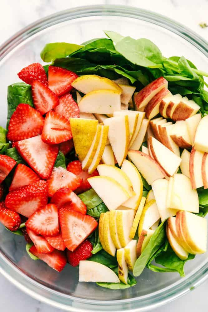 Strawberry, Apple, and Pear Spinach Salad ingredients in a bowl.