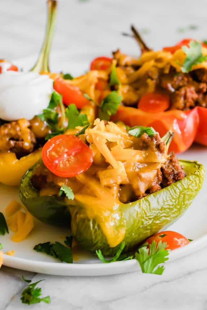 Taco Stuffed Peppers on a white plate.