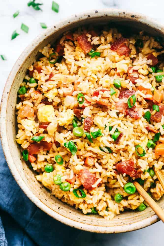 Bacon Fried Rice in a serving bowl with chop sticks.