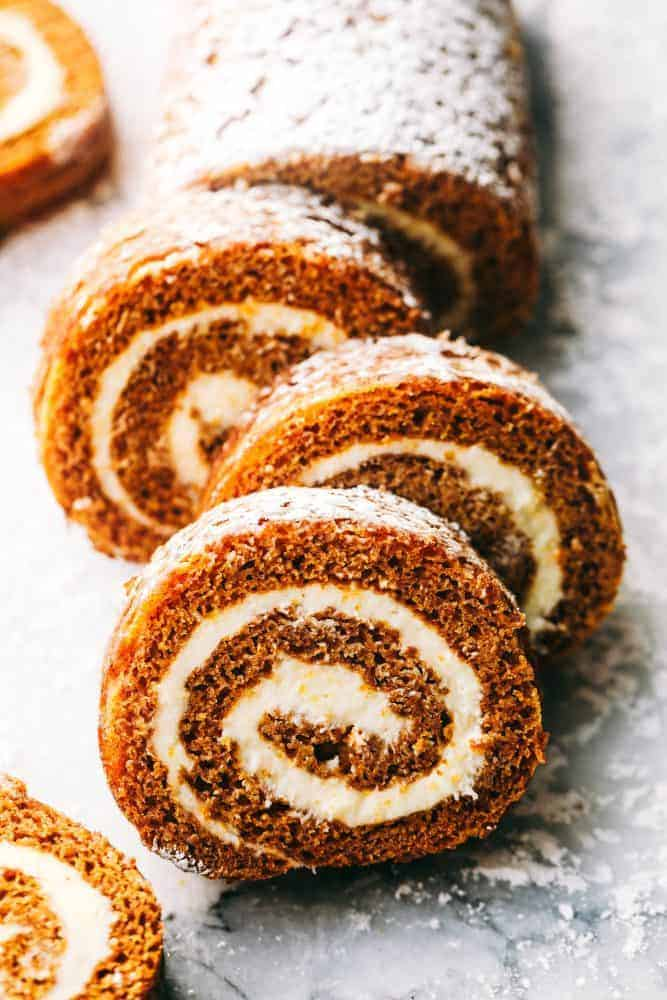Pumpkin Roll cut up with powdered sugar sprinkled on top.