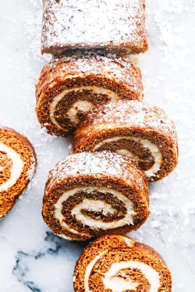 Sliced Pumpkin Roll with powdered sugar on top.