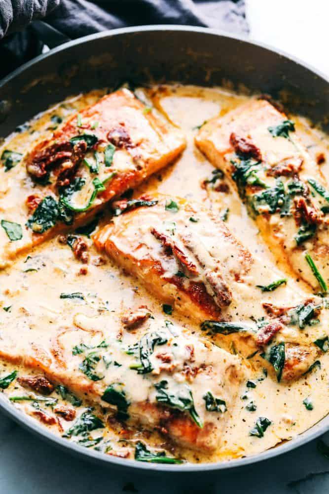 Creamy Tuscan garlic salmon in a frying pan.