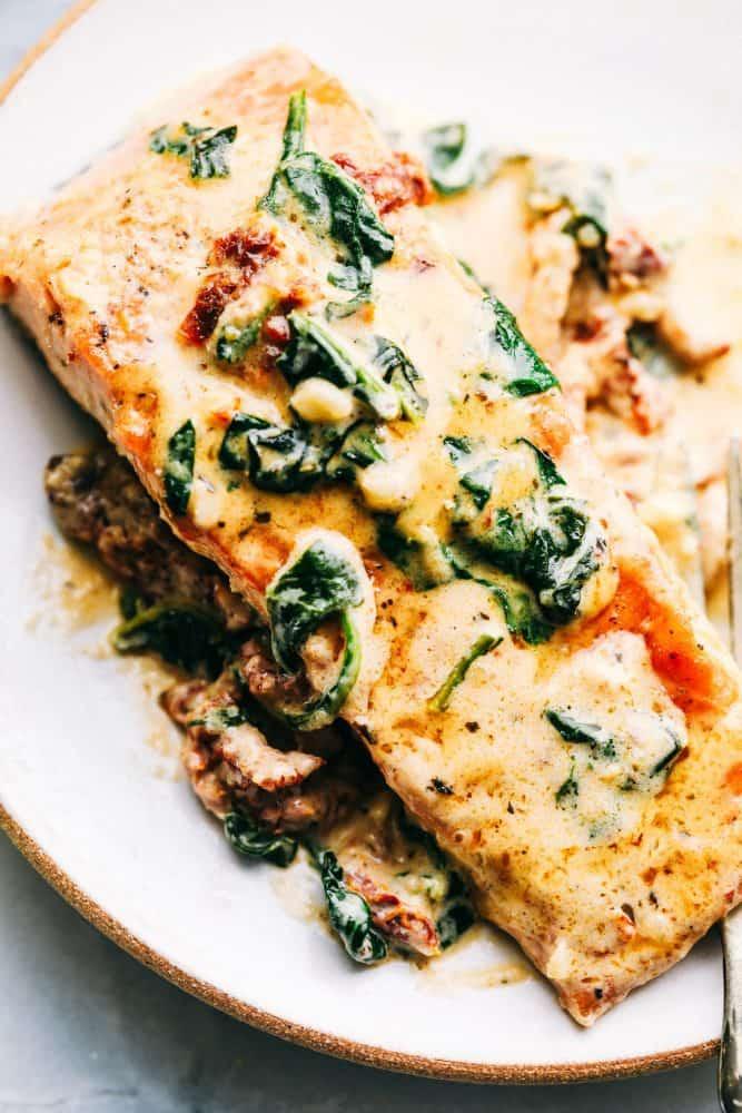 Tuscan garlic salmon on a white plate.