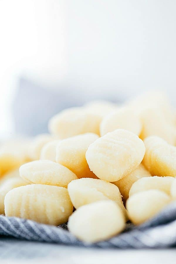 A photo with gnocchi stacked on top of each other.