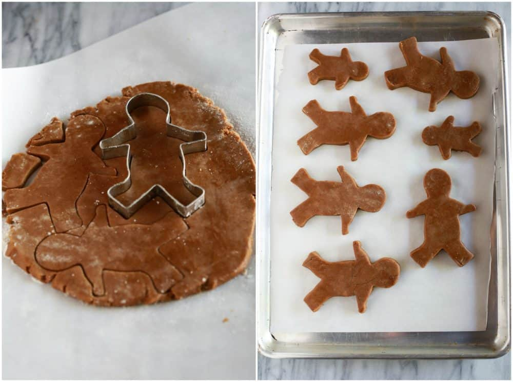 Gingerbread Cookies cut out with the gingerbread man then placed on a cookie sheet.