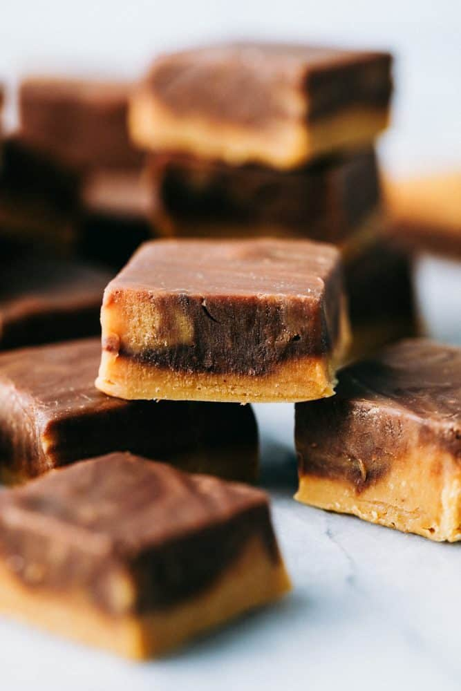 Peanut butter chocolate fudge stacked on top of each other.
