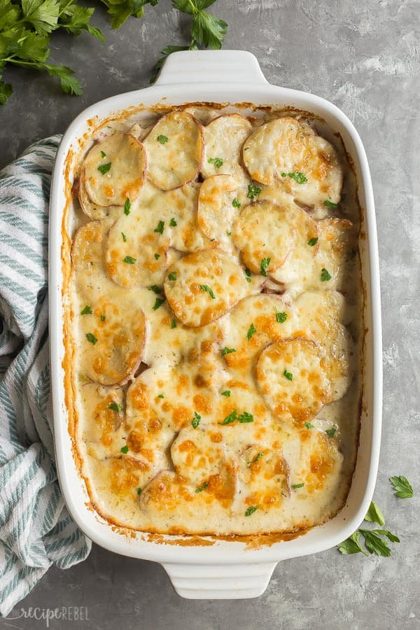 scalloped potatoes and ham in white dish