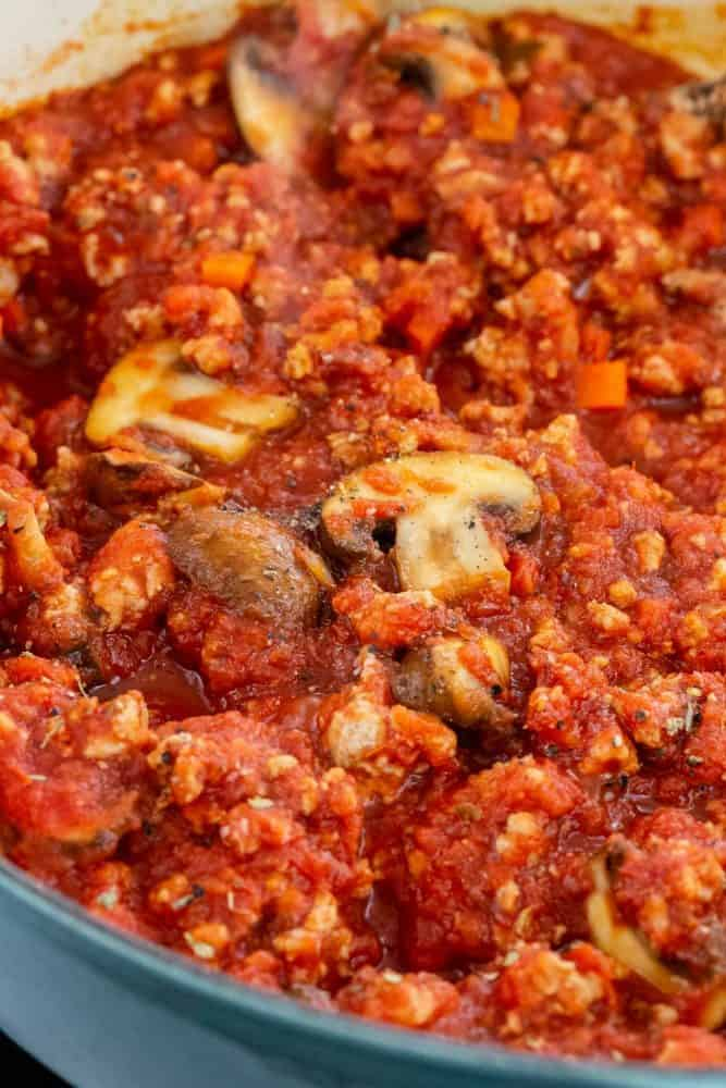 close up photo of meat sauce in a pan