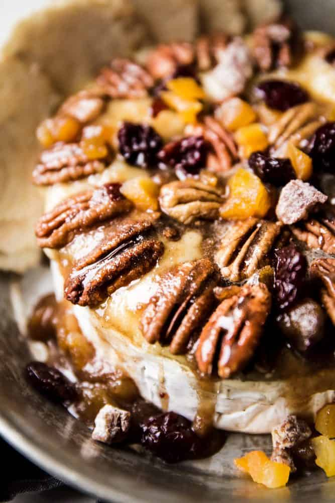 Maple pecan baked brie and a serving dish with chips on the side.
