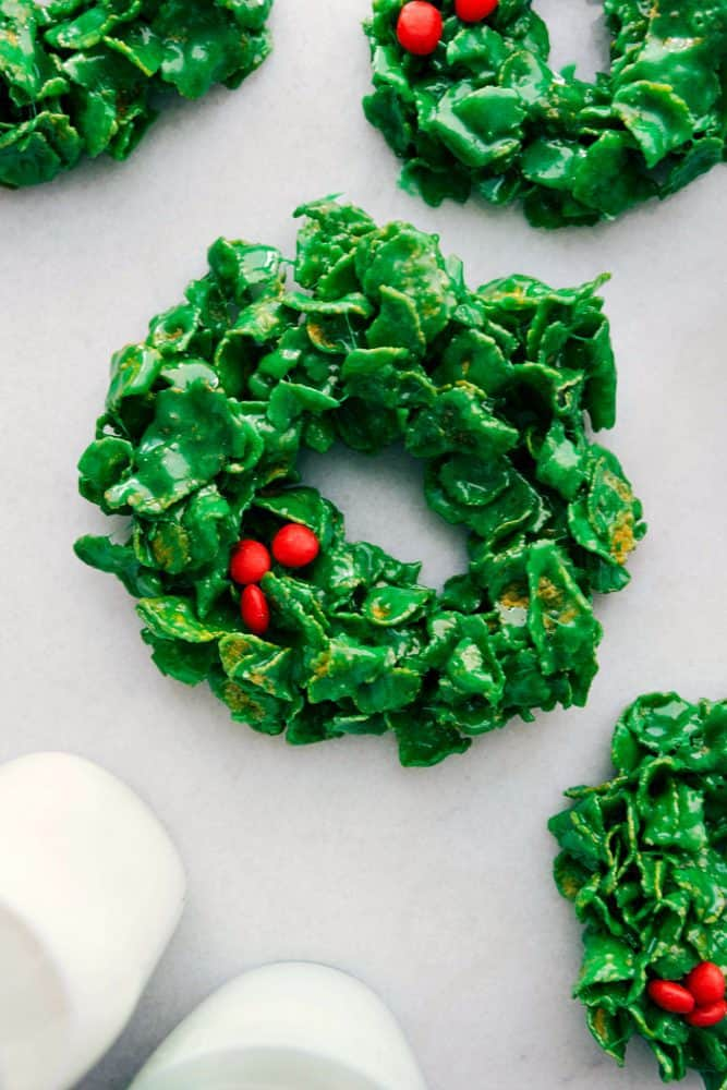 Christmas cornflake wreaths on a table.