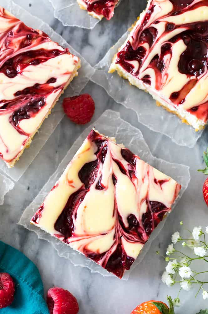 Overhead view of the swirls in berry swirl cheesecake bars