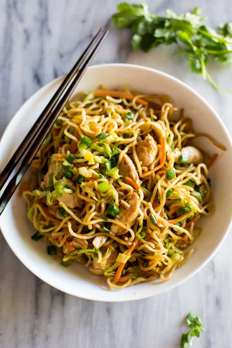 Chicken Chow Mein in a white bowl with chopsticks.