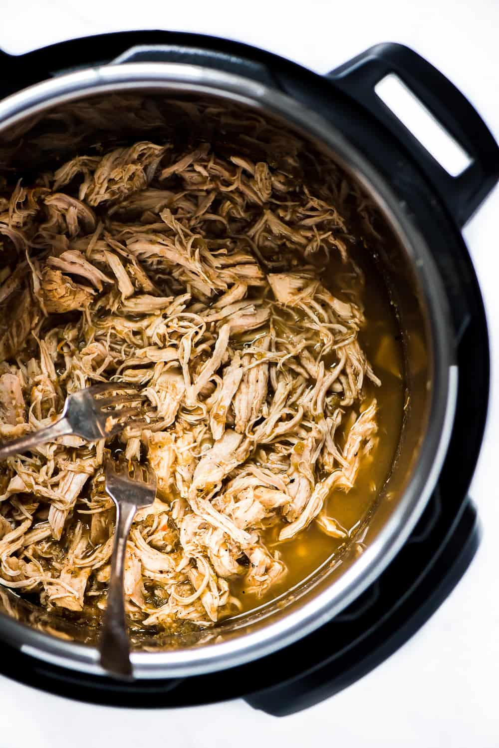 Cooked chicken in the crock pot.