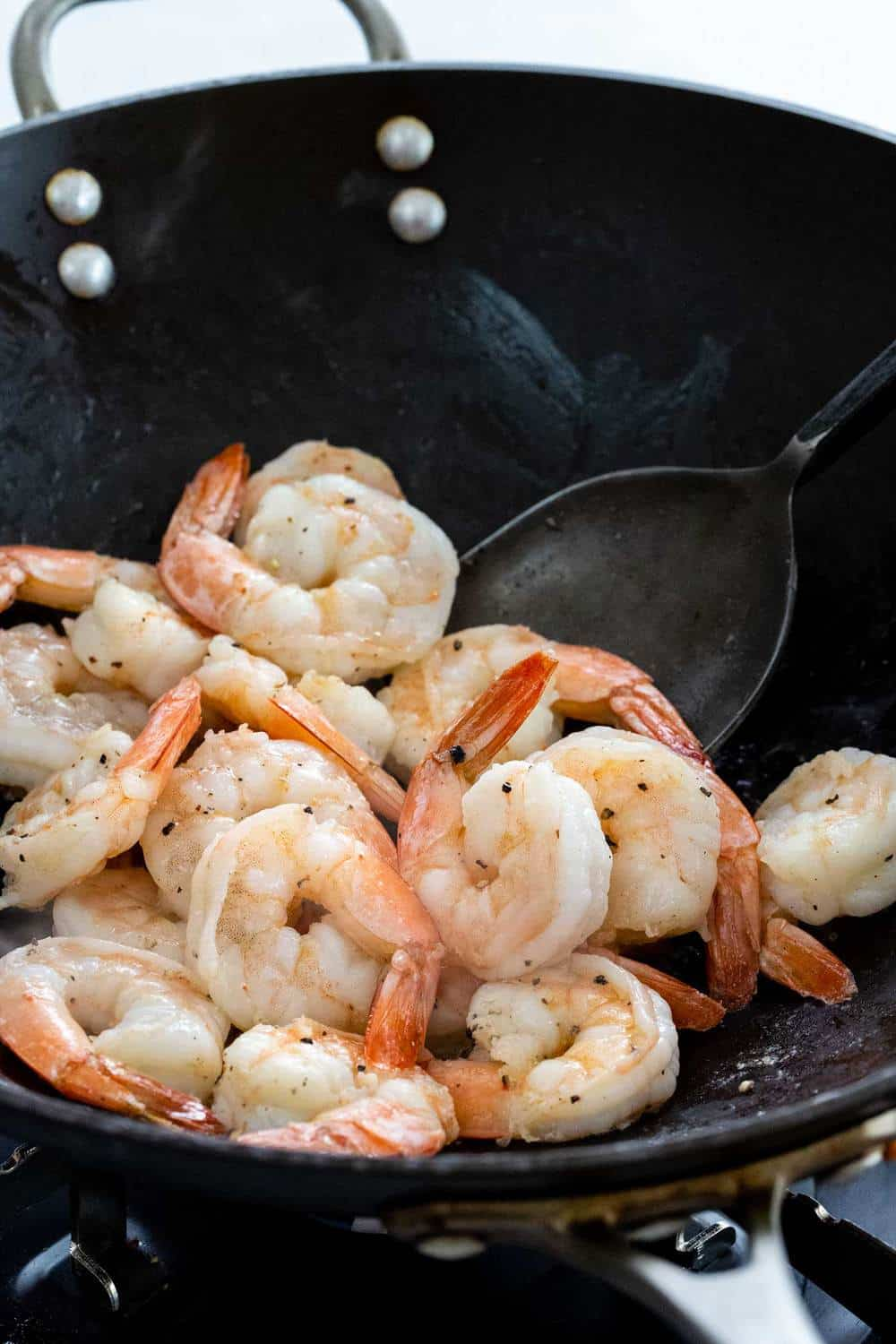 shrimp cooking in a wok