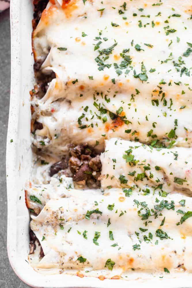 Salsa Verde Beef and Mushroom Enchiladas in a pan.