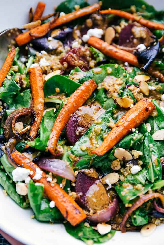 This roasted beet, quinoa, and carrot salad is packed with healthy and good-for-you ingredients! It's super flavorful and has the best lemon dressing!