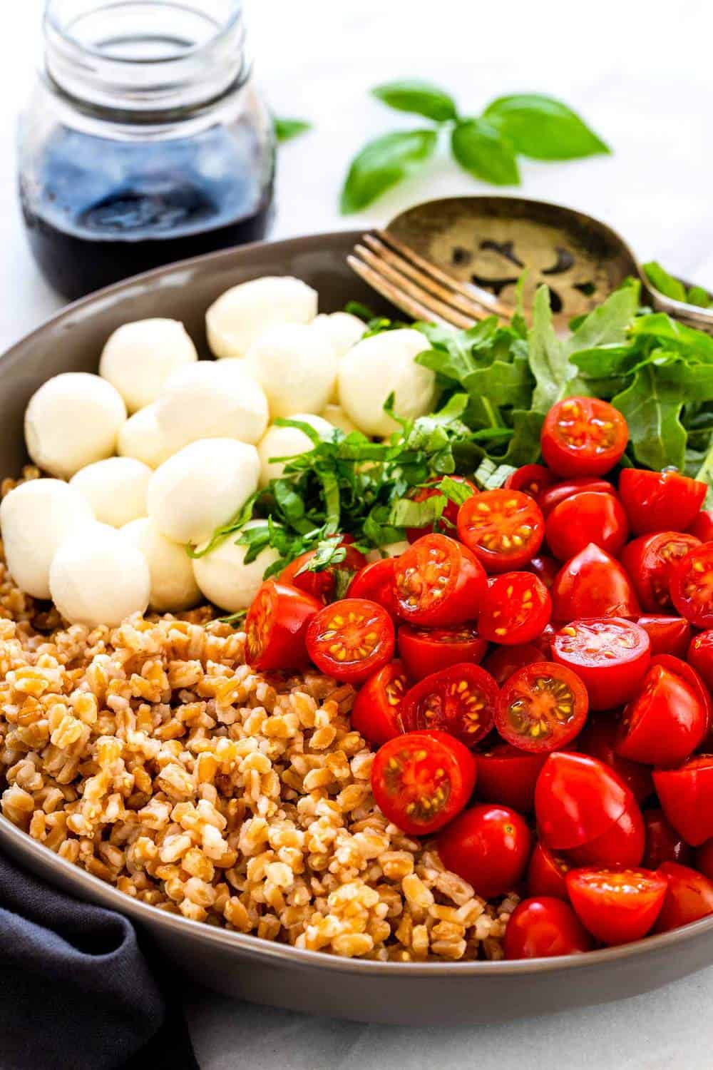Farro Caprese Salad ingredients in a bowl