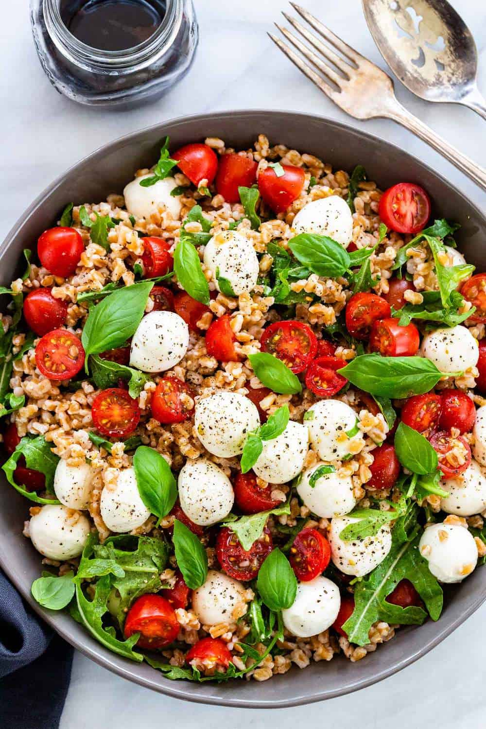 Farro Caprese Salad mixed together in a bowl