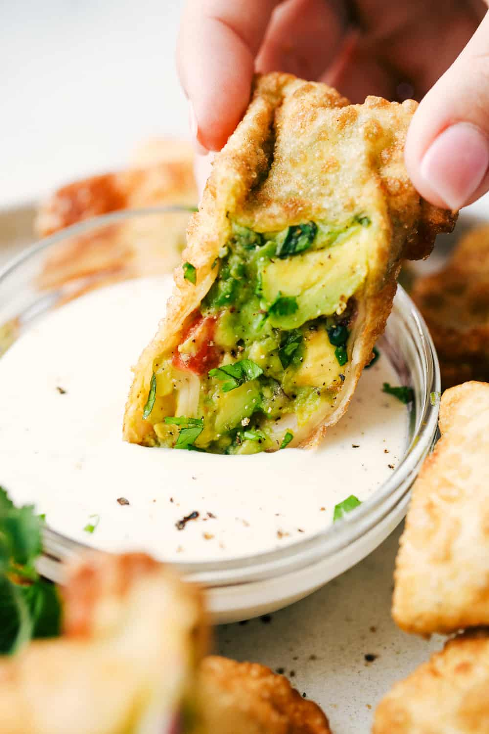 Dipping avocado egg roll.