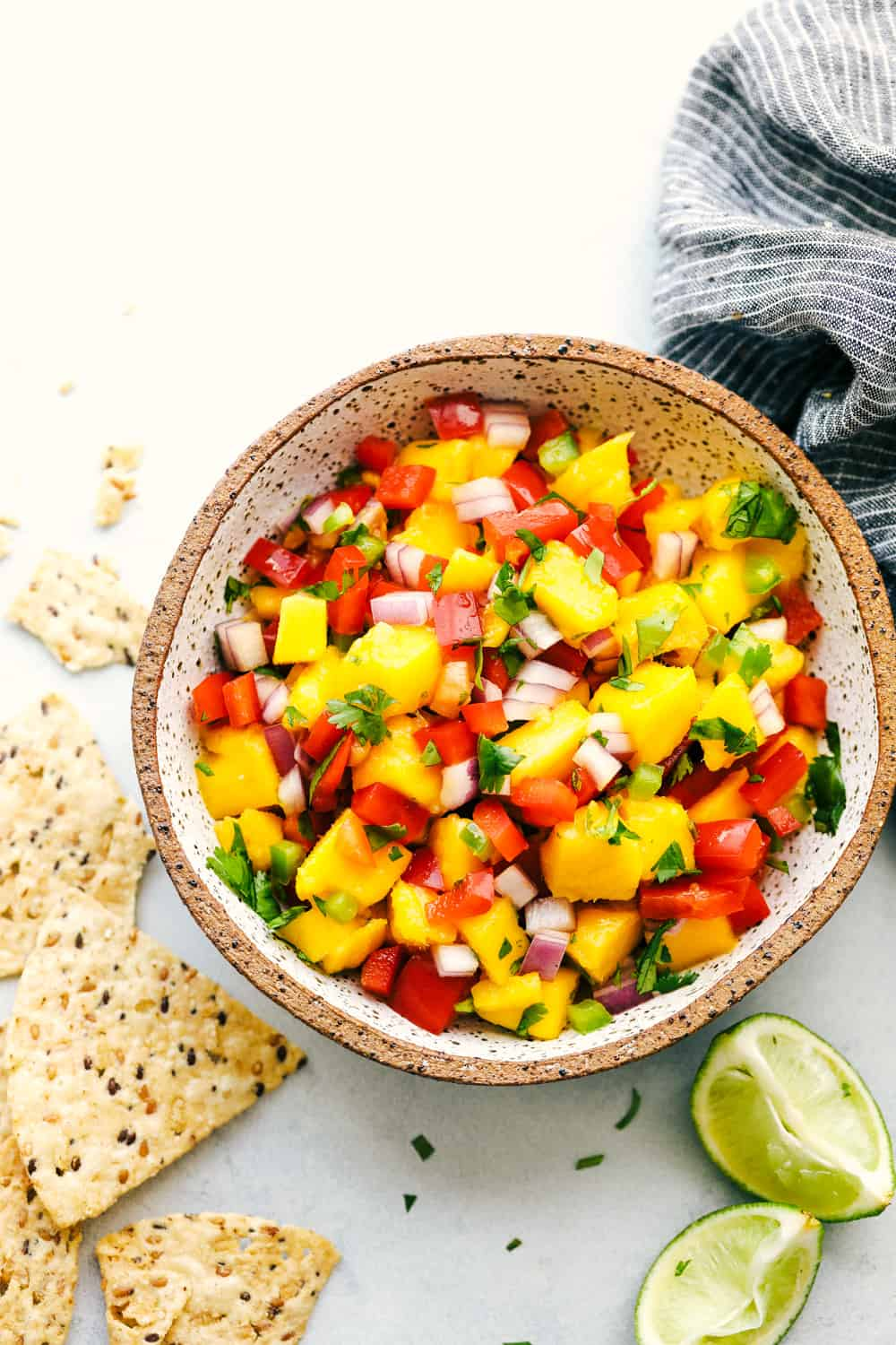 Overhead view of mango salsa in a bowl.