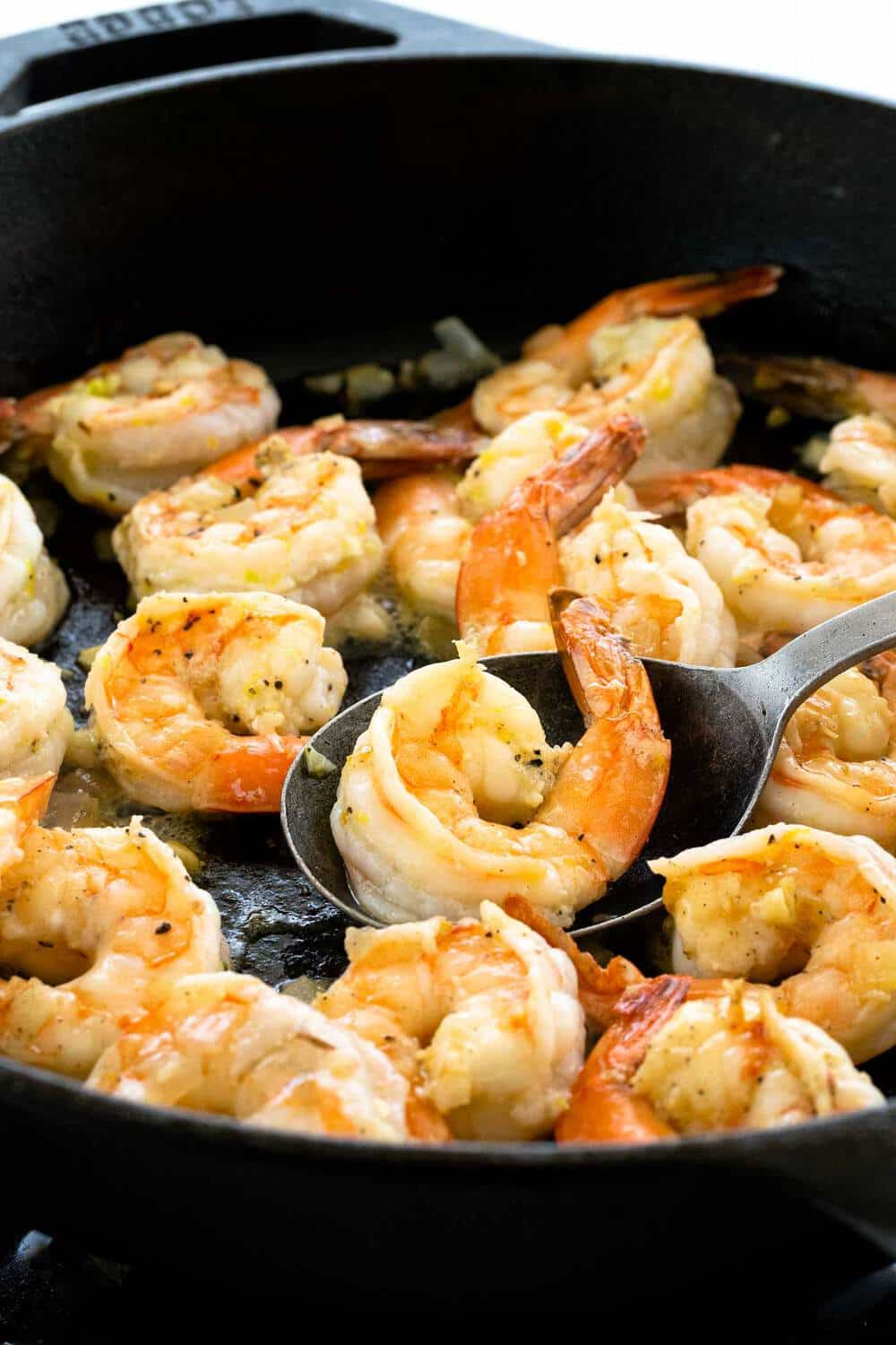 shrimp cooking in a cast iron skillet