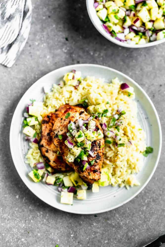 This Grilled Chipotle Chicken with Pineapple Salsa on a white plate.