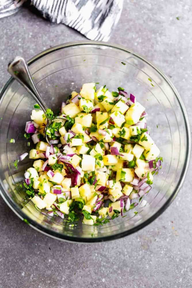 Pineapple salsa in a glass bowl.