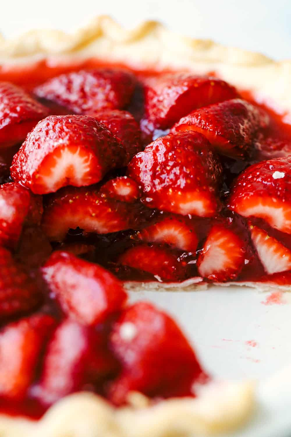 Close up on a slice of strawberry pie.