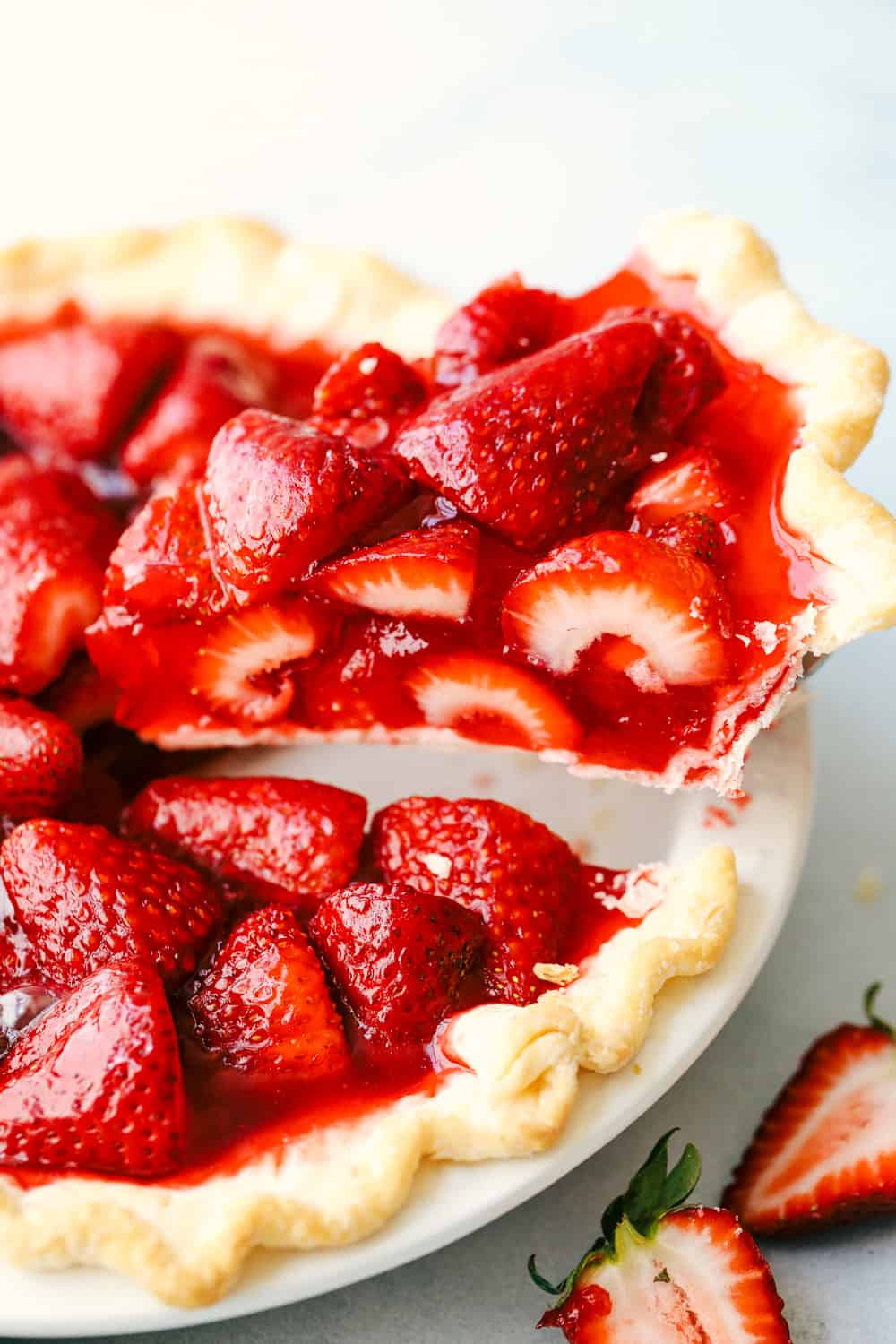 Pulling out a slice of strawberry pie.