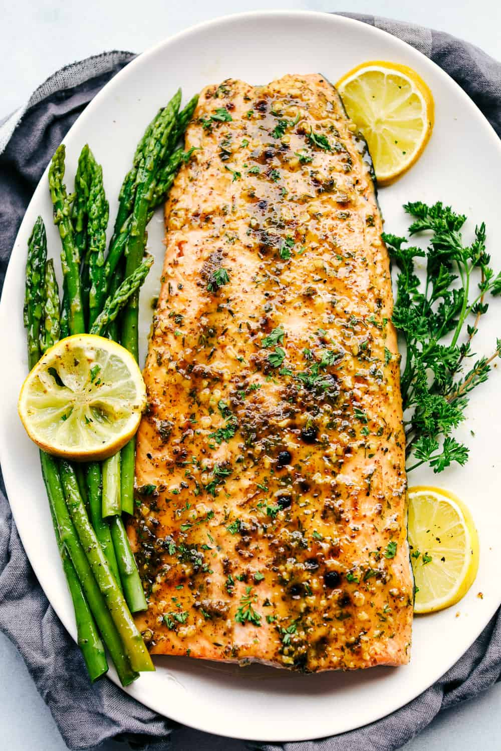 honey dijon broiled salmon on a plate with asparagus