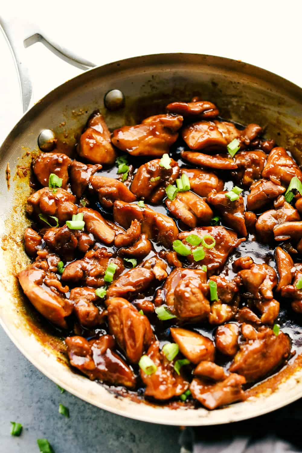 Best Bourbon Chicken is juicy, tender chicken thighs cut into pieces simmered in a sweet, brown sugar glaze that will melt in your mouth. Rich in flavor and served over rice for a complete meal!