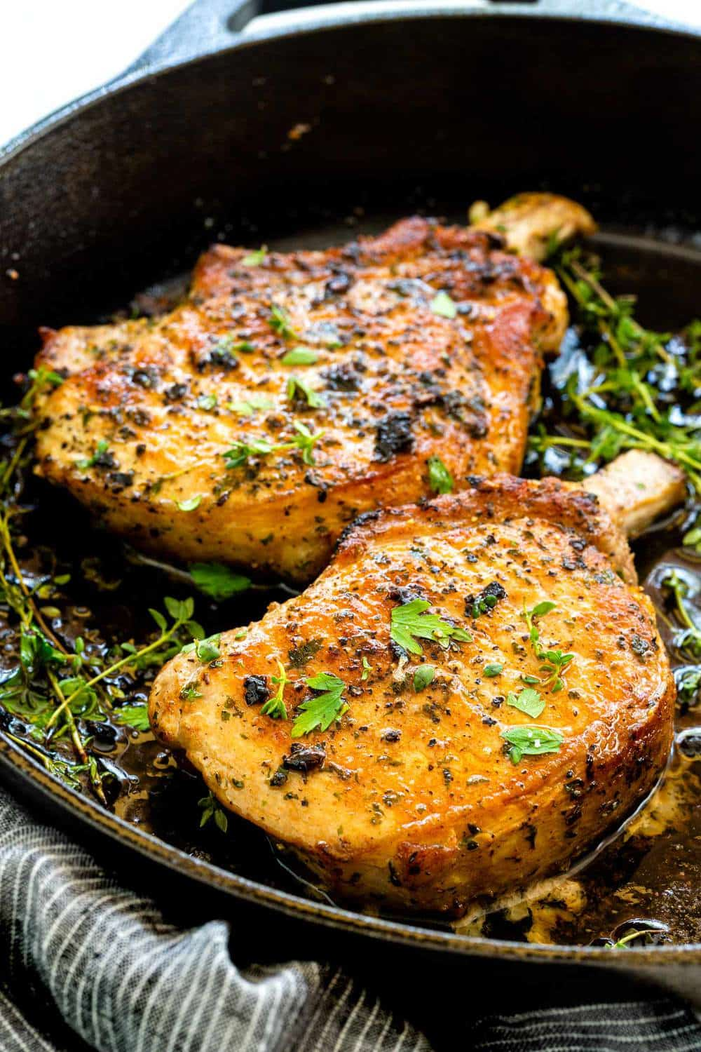 pork chops cooked in a cast iron skillet