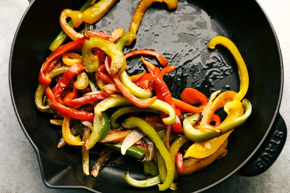 bell peppers sautéing in a skillet