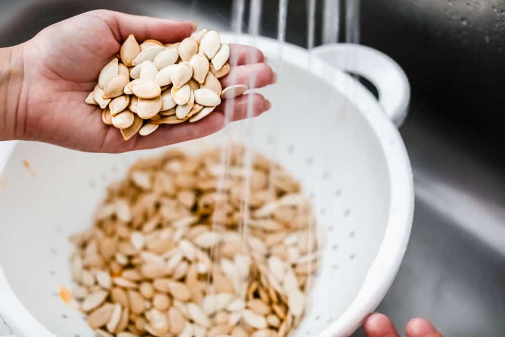 Rinsing off the pumpkin seeds