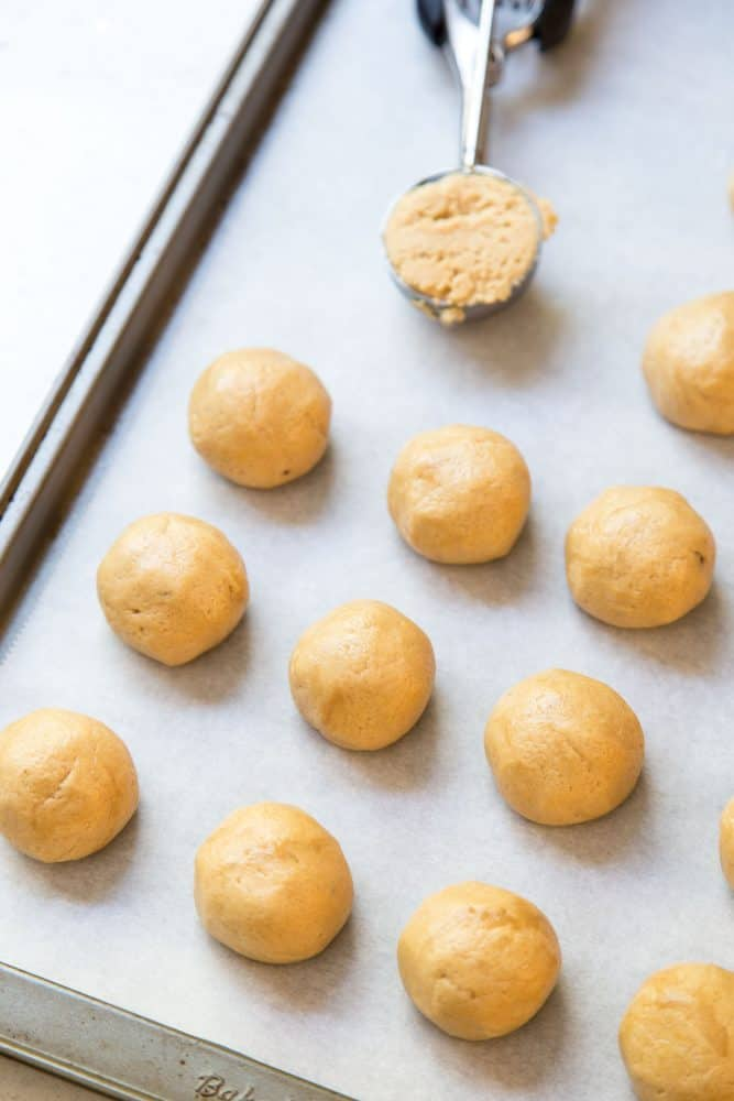Portioning peanut butter blossom cookie dough