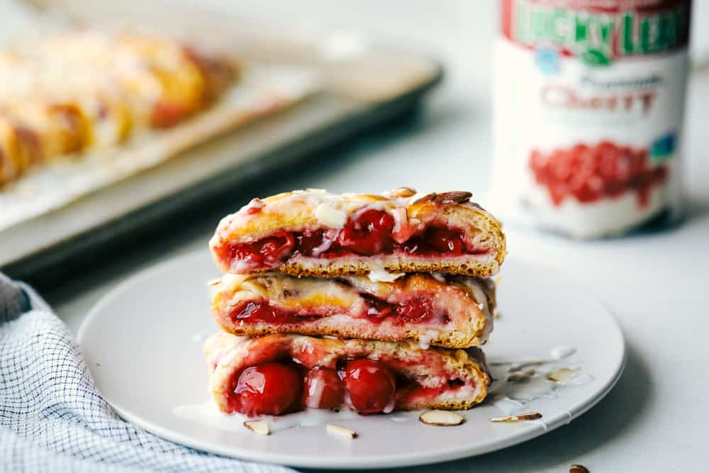 Slices of cherry almond cream cheese breakfast braid on a plate