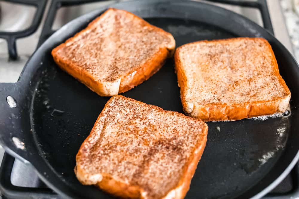 cooking French toast in a skillet on the stove top.
