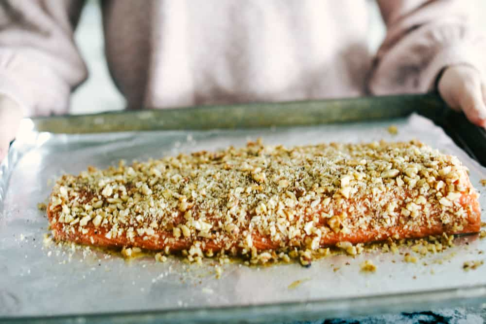 Walnut crusted maple salmon on a sheet pan and ready to bake.
