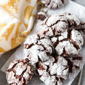 Chocolate crinkle cookies on a wire grate