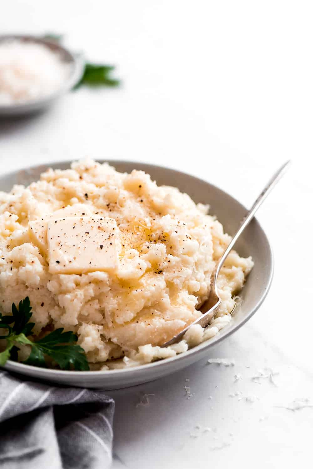 Mashed cauliflower in a bowl with butter on top