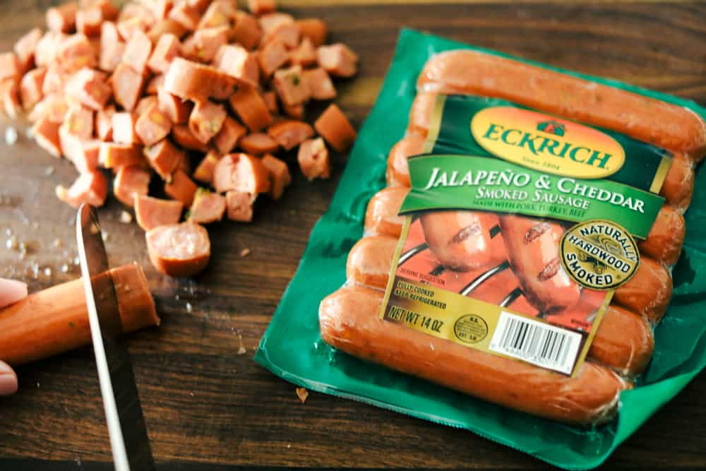 Eckrich jalapeno & cheddar smoked sausage package and cut up sausage next to it.