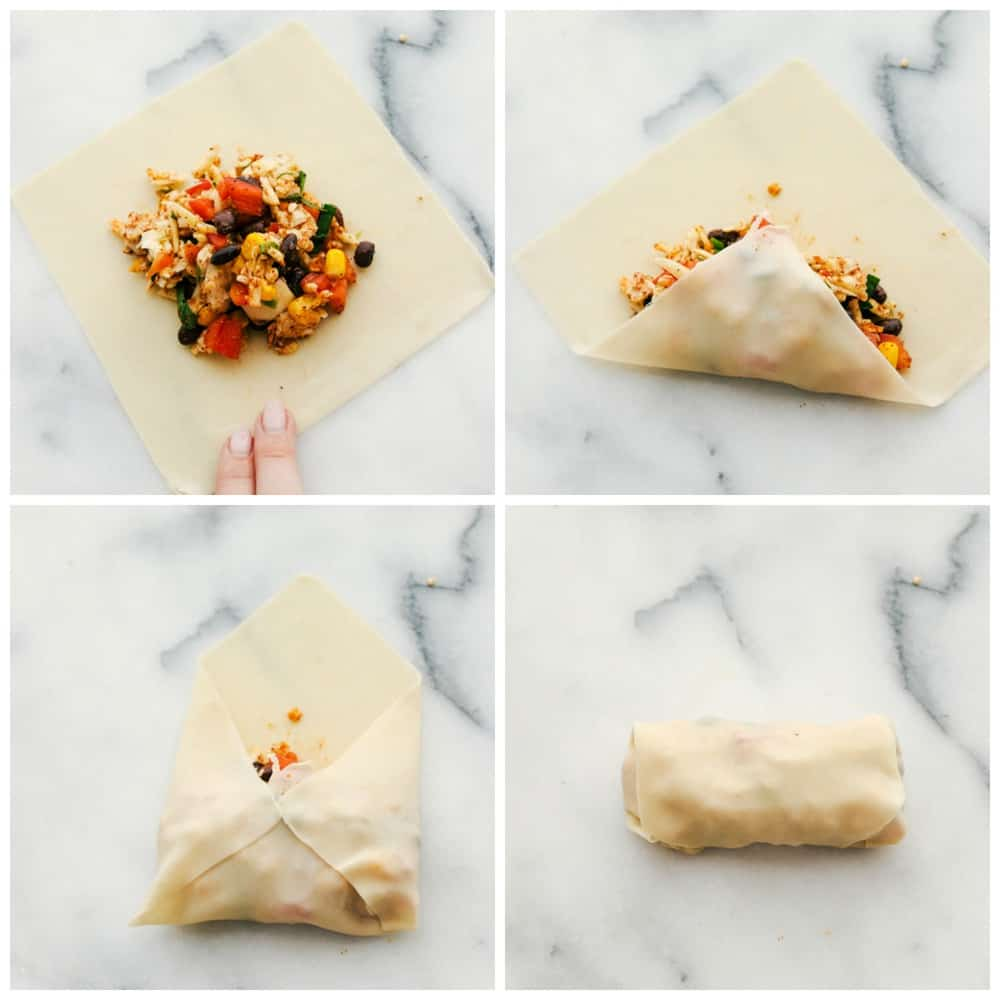 The process of wrapping the egg roll up with the egg roll mixture.