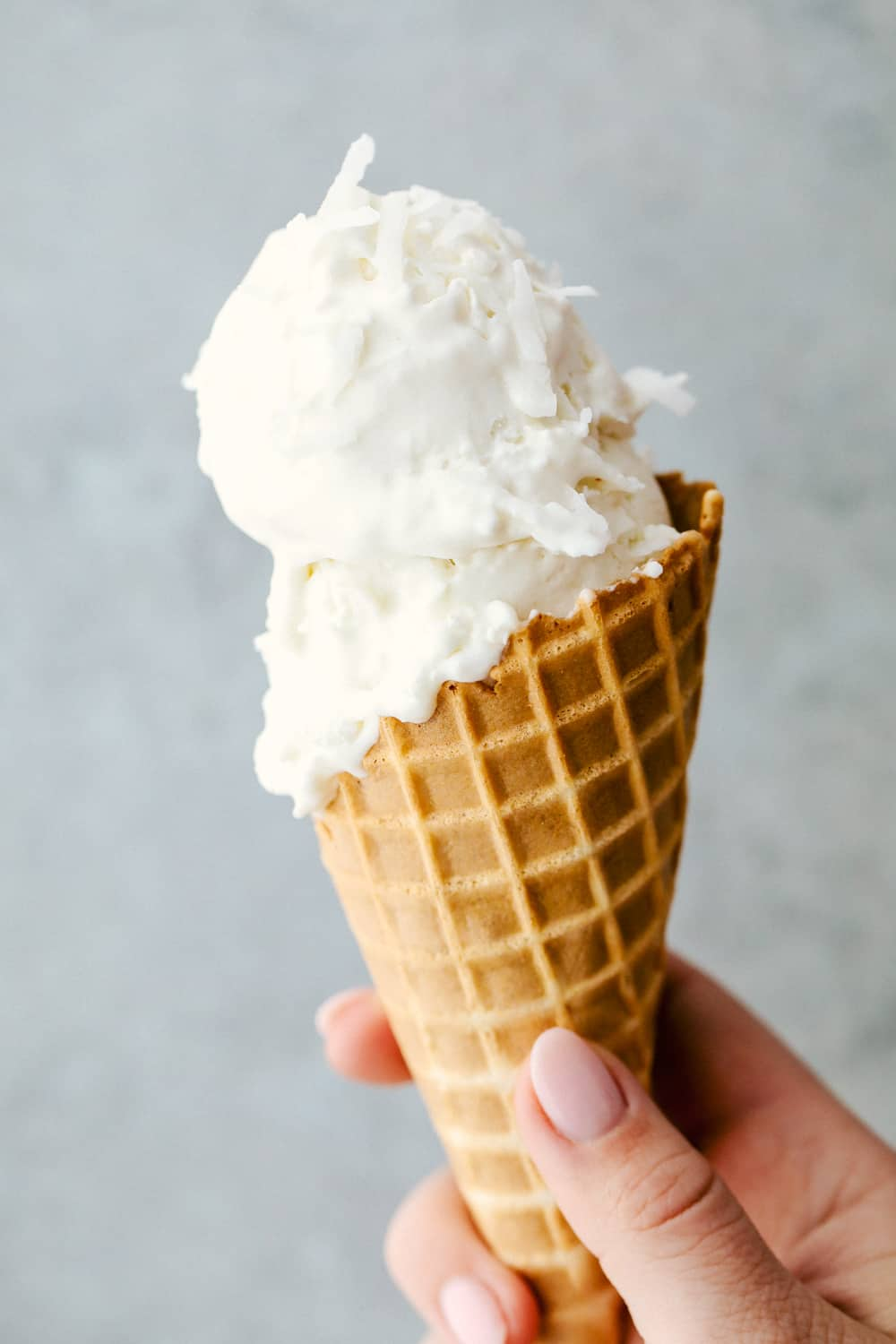 Keto ice cream in a waffle cone with two scoops.